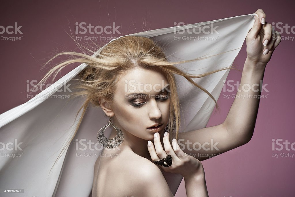 Beautiful woman with ring and earrings royalty-free stock photo