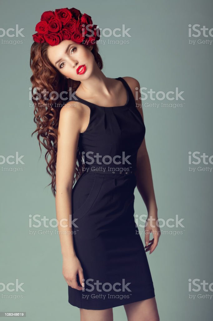 Beautiful woman with roses on the head stock photo