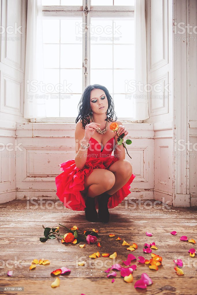 Beautiful woman with roses stock photo