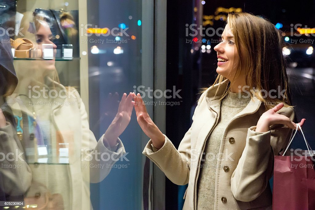 Beautiful woman with shopping bag at night stock photo