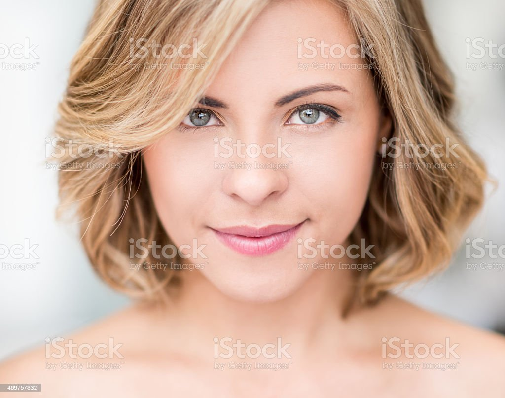 Beautiful woman with short hair stock photo
