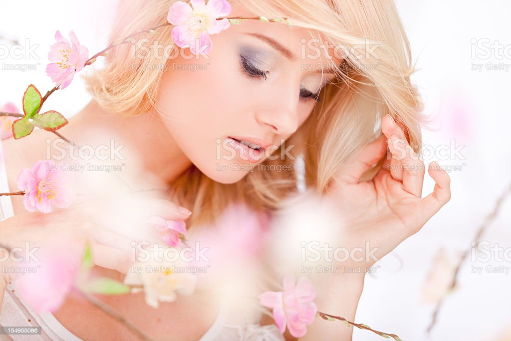 beautiful woman with spring flowers stock photo