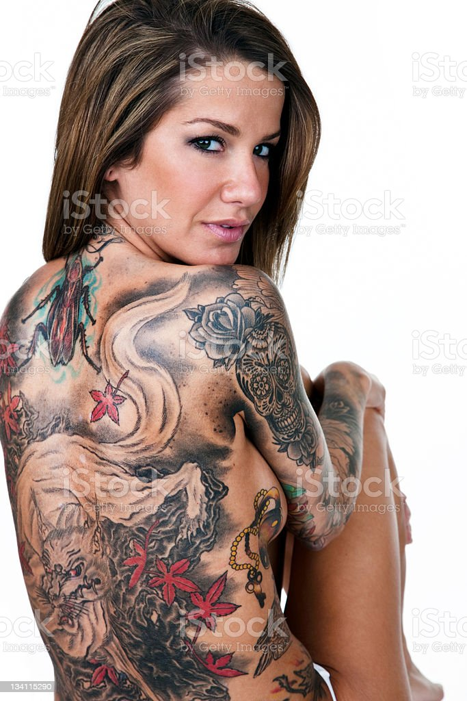 Beautiful woman with tattooed back royalty-free stock photo