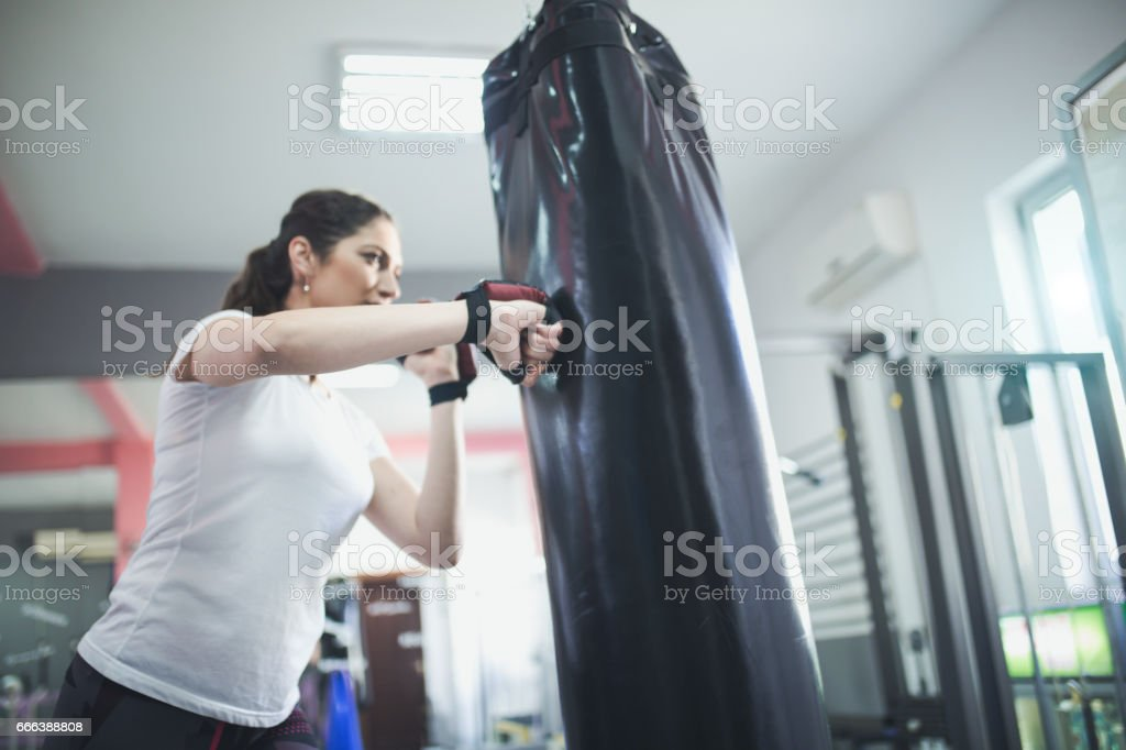 Beautiful Woman with the Boxing Gloves. Attractive Female Boxer Training. stock photo