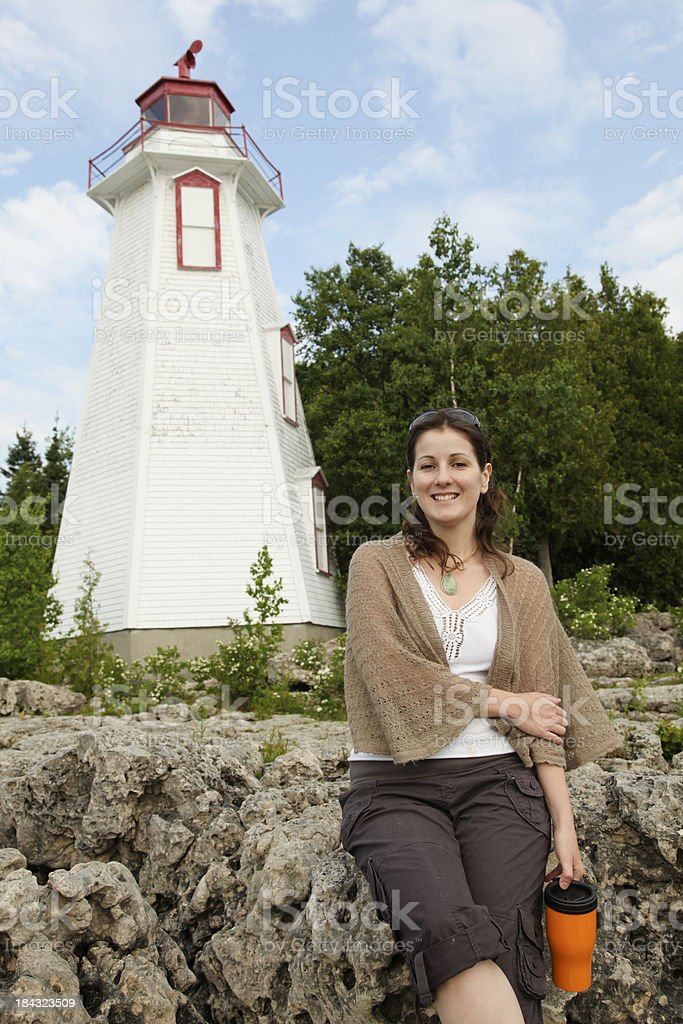 Beautiful woman with Tobermory`s famous Big Tub Lighthouse stock photo