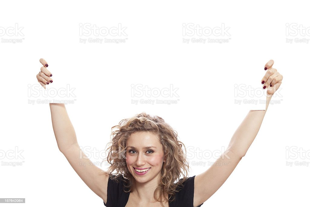 Beautiful woman with toothy smile holding blank sign stock photo