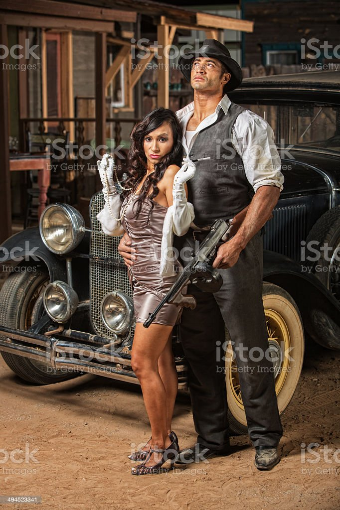Beautiful Woman with Tough Gangster stock photo