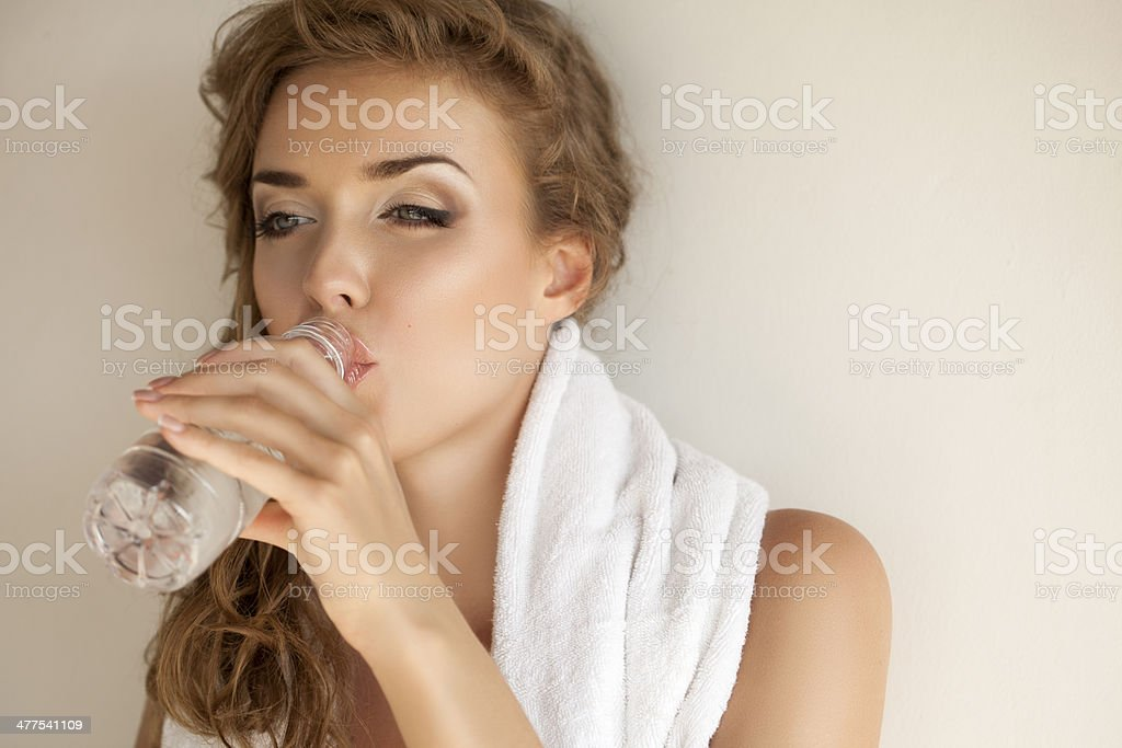Beautiful woman with towel and bottle of water royalty-free stock photo