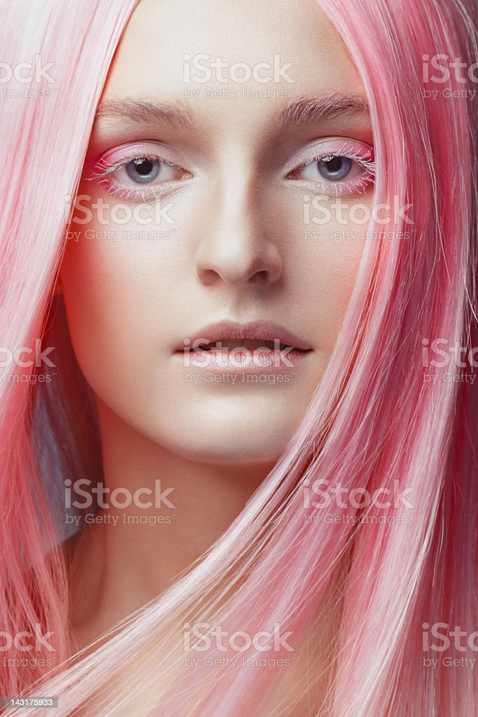Beautiful woman with trendy hairstyle and make-up stock photo