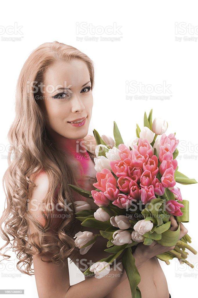 Schöne Frau mit Tulpen Lizenzfreies stock-foto
