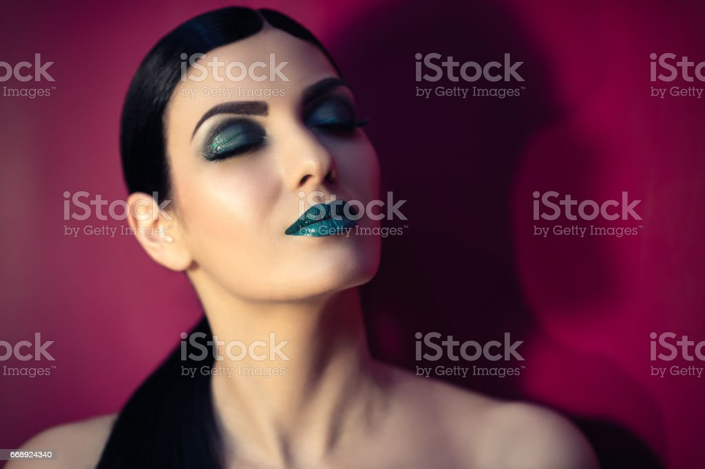 beautiful woman with turquoise makeup stock photo