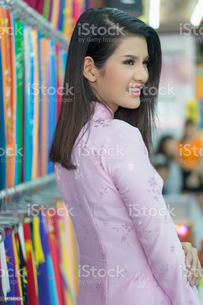 Beautiful woman with Vietnam culture traditional dress, Ao dai is famous traditional costume , Hoi an Vietnam. stock photo