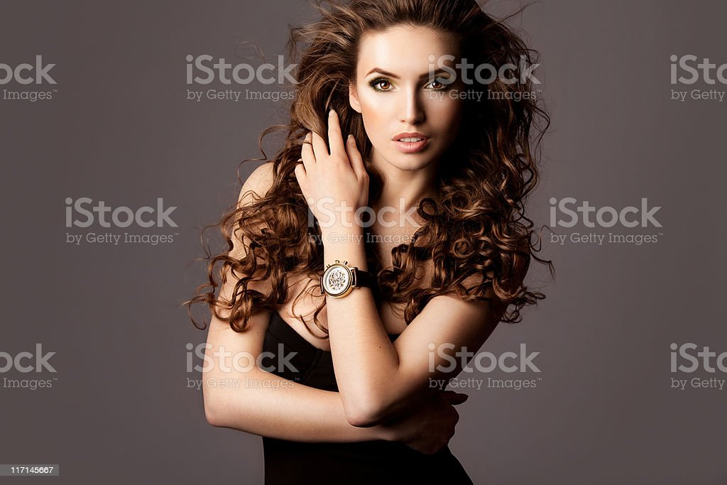 Beautiful woman with watches royalty-free stock photo