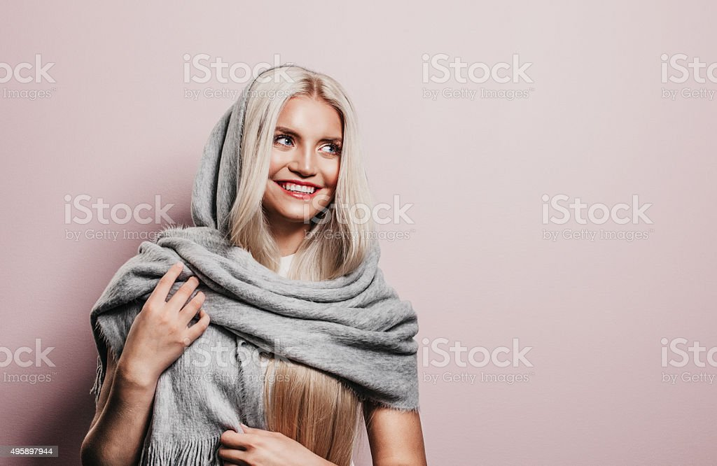 Beautiful woman with winter scarf stock photo