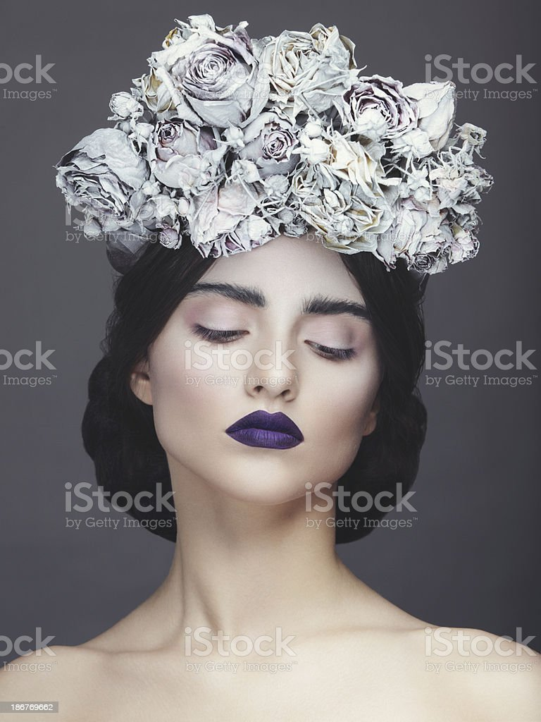 Beautiful woman with wreath of flowers stock photo