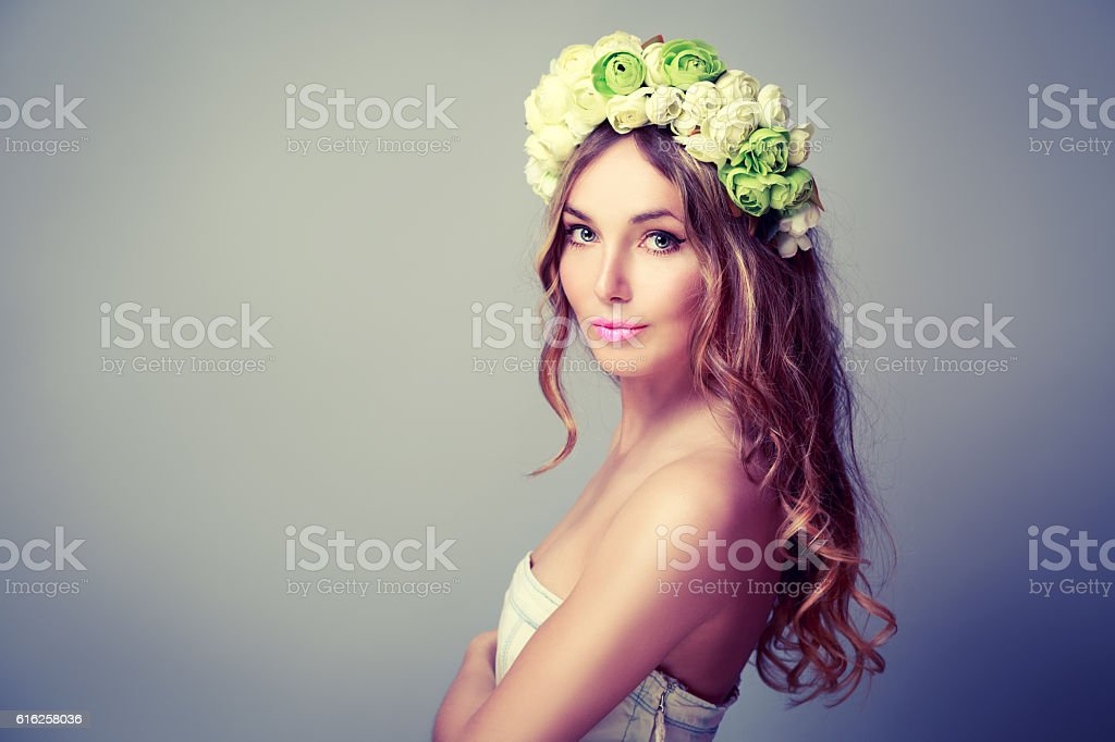 Beautiful Woman with Wreath of Roses stock photo