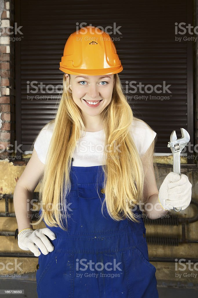 Beautiful Woman With Wrench royalty-free stock photo