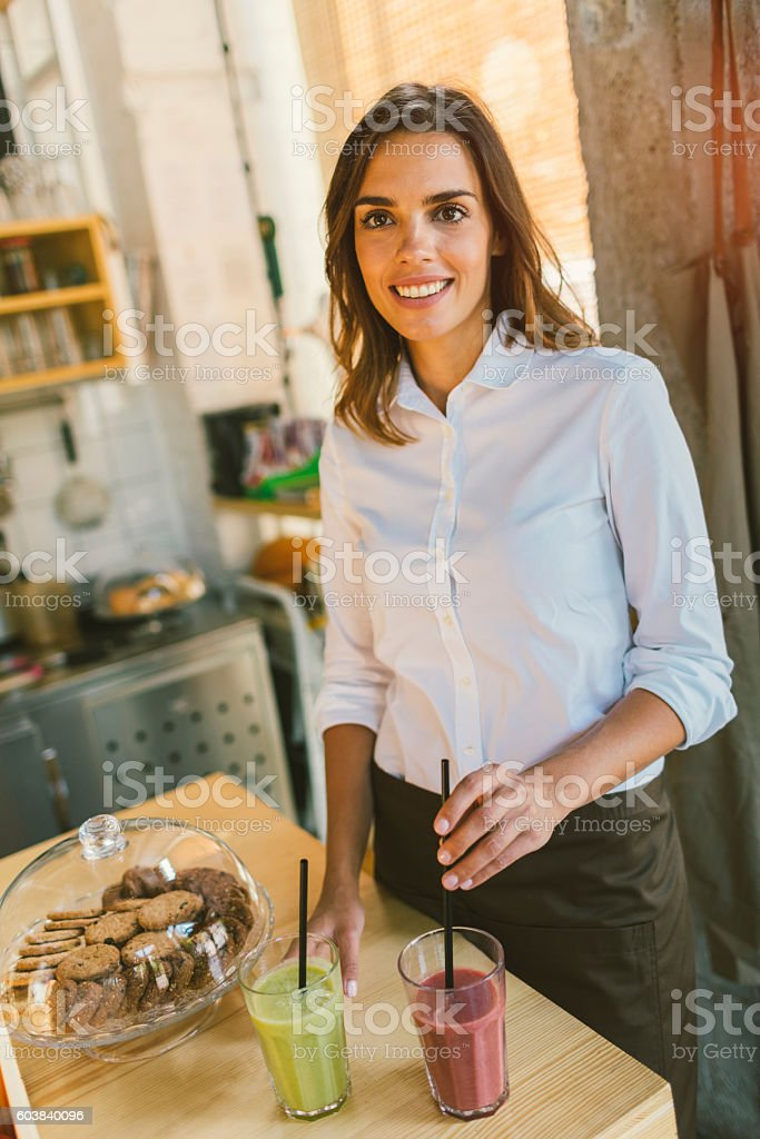 Beautiful Woman Working In Her Cafe stock photo