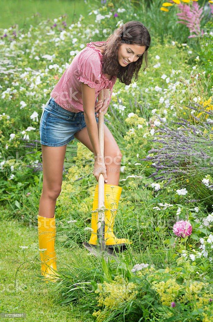 Beautiful Woman working in her Garden stock photo