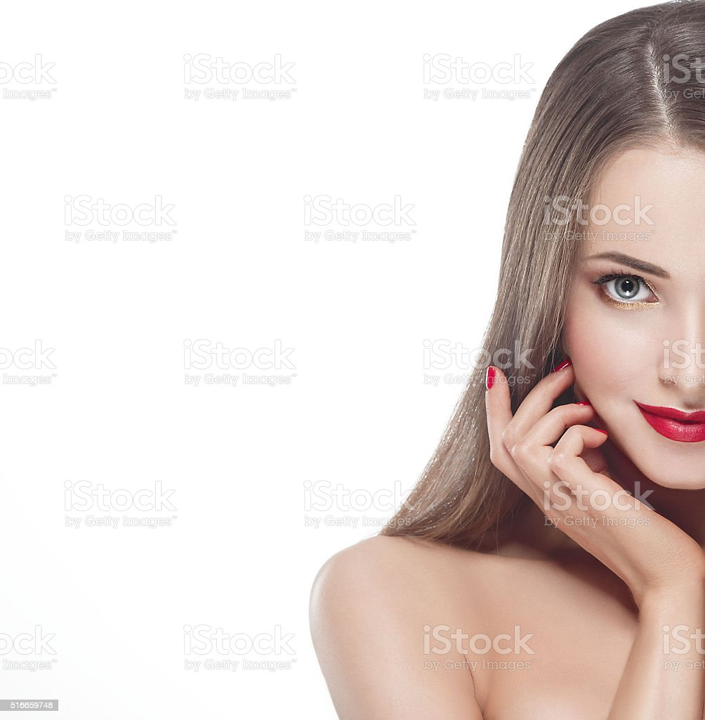 Beautiful woman young half-face with red lips and red manicure stock photo
