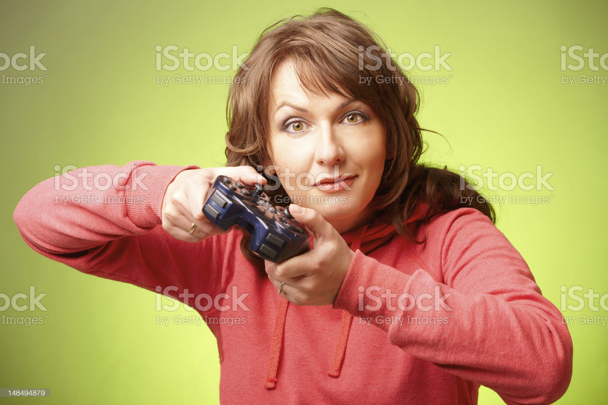 Beautiful womanl with gamepad playing vieogame royalty-free stock photo