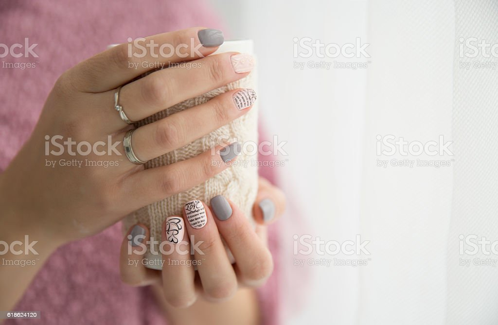 beautiful woman's hands holding a cup stock photo