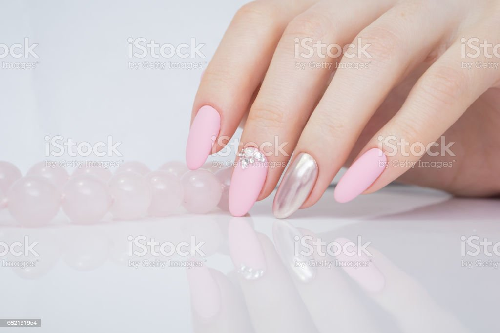 Beautiful woman\'s hands. Natural nails and manicure. Spa procedure.
