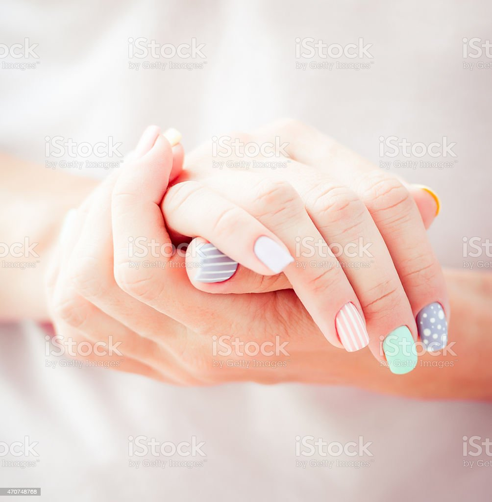 Beautiful woman's hands with painted nails stock photo