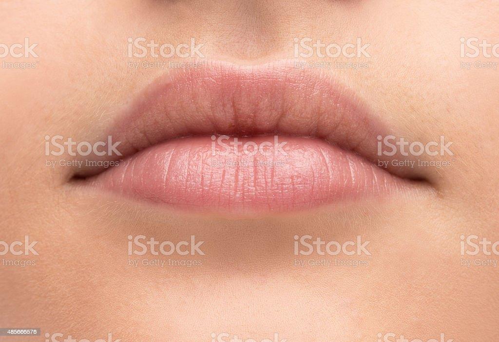 Beautiful woman's lips close-up stock photo