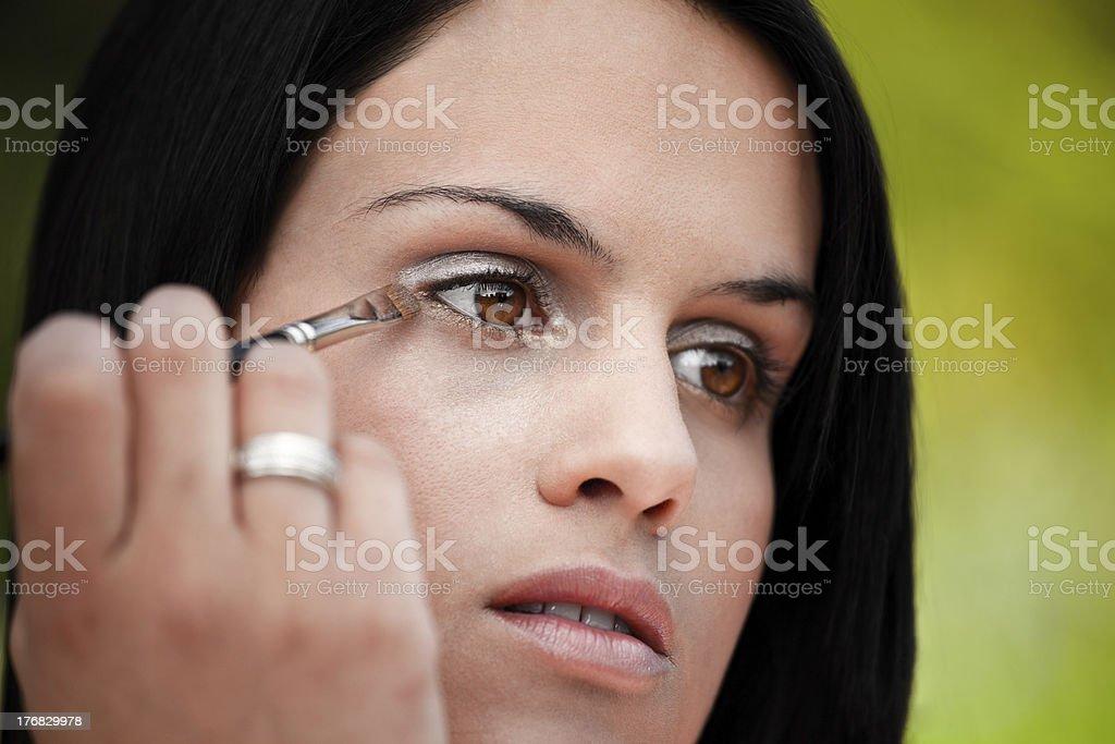 Beautiful women applying eye shadow royalty-free stock photo