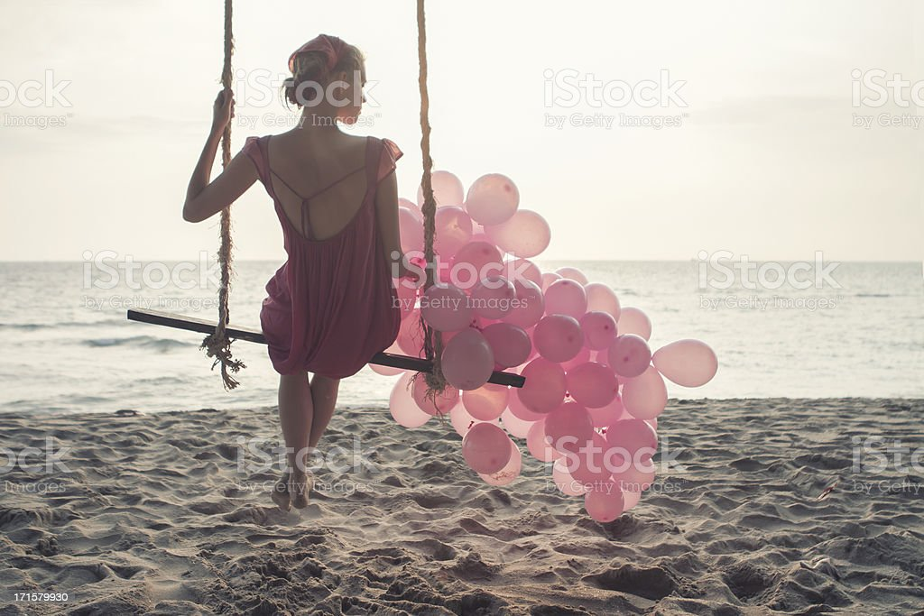 beautiful women at swing with pink ballons stock photo