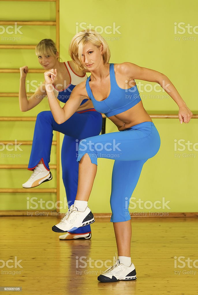 Beautiful women exercising in fitness club royalty-free stock photo