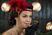 Beautiful women in Greate Gatsby style with glass of wine