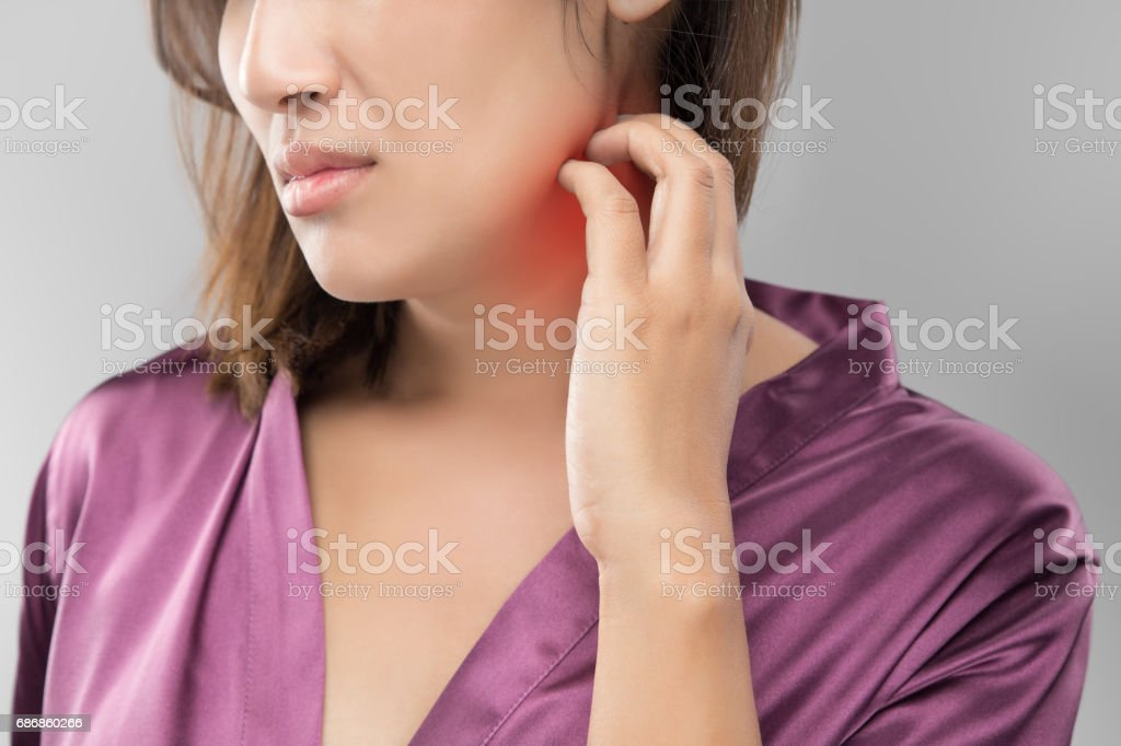 Beautiful women itching and scratching by hand, Closeup, Healthcare And Medicine - People with skin problem concept. stock photo