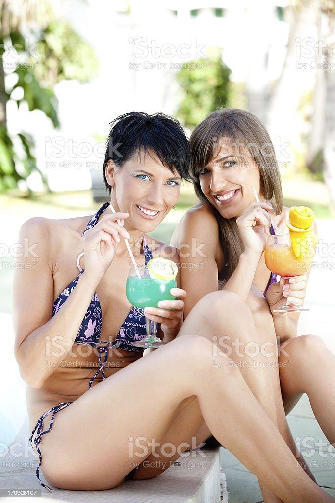 Beautiful women on poolside royalty-free stock photo