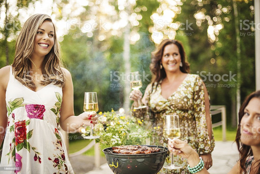 Beautiful women outdoors on patio stock photo