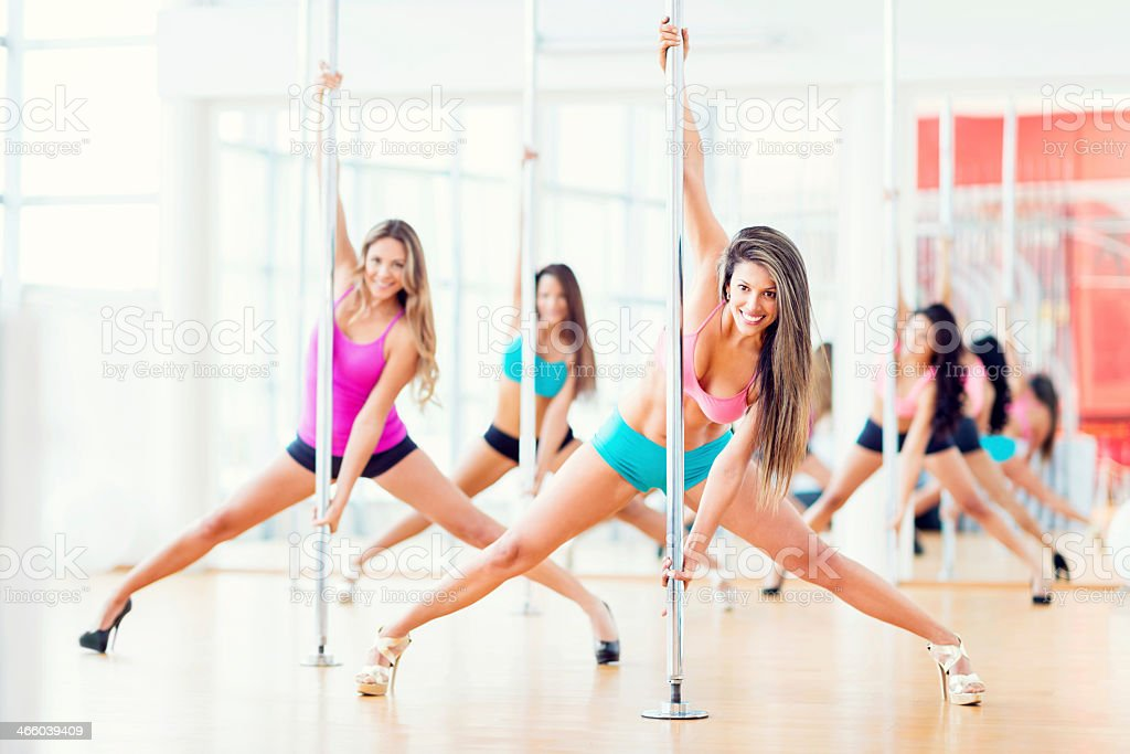 Beautiful women pole dancing stock photo