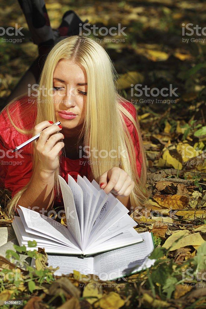 beautiful women reading outdoor stock photo
