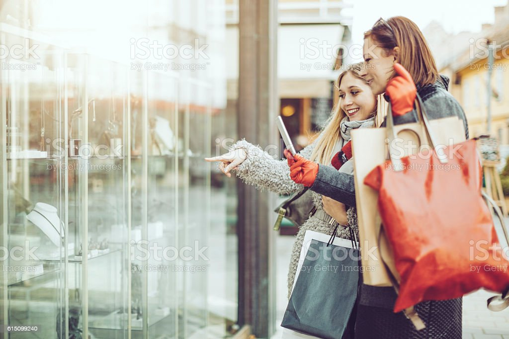 Beautiful women shopping in the city stock photo