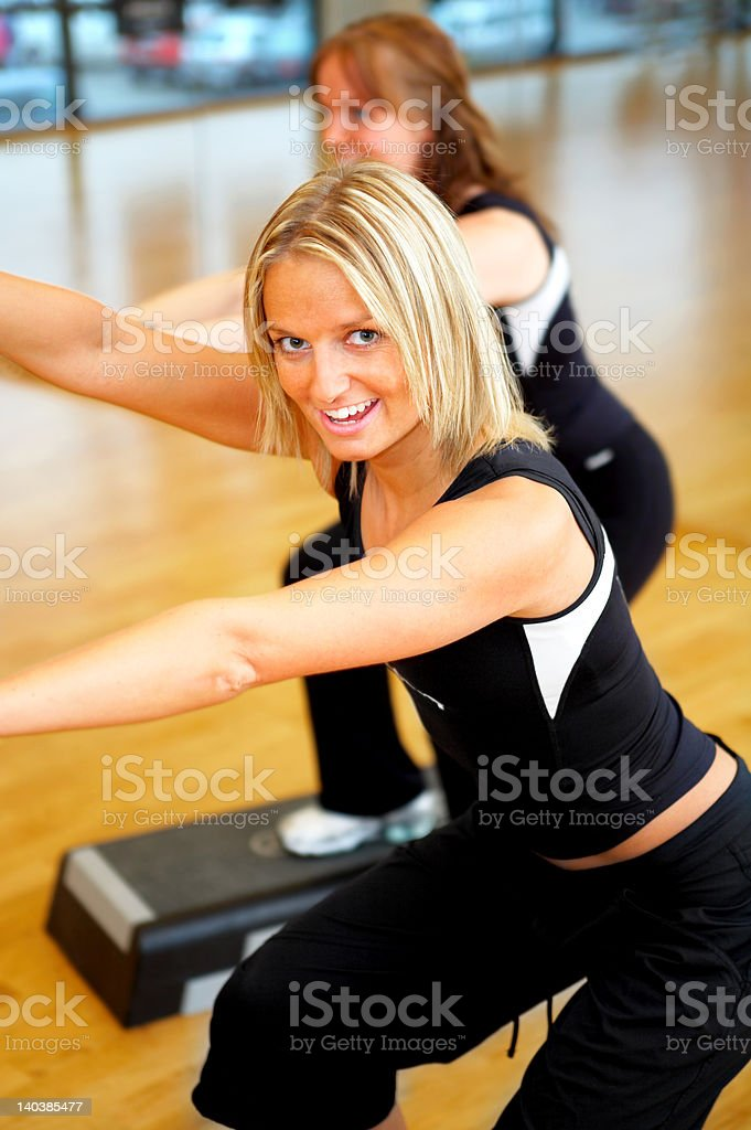 Beautiful women stepping in a fitness center royalty-free stock photo