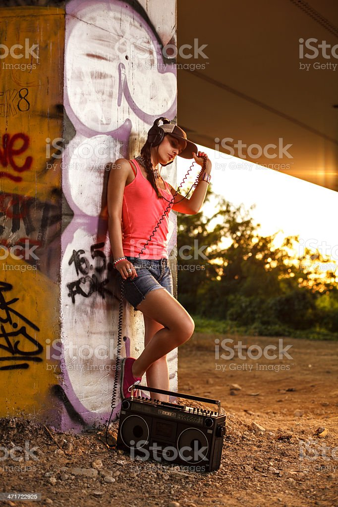 Beautiful women with a tape recorder and headphones royalty-free stock photo