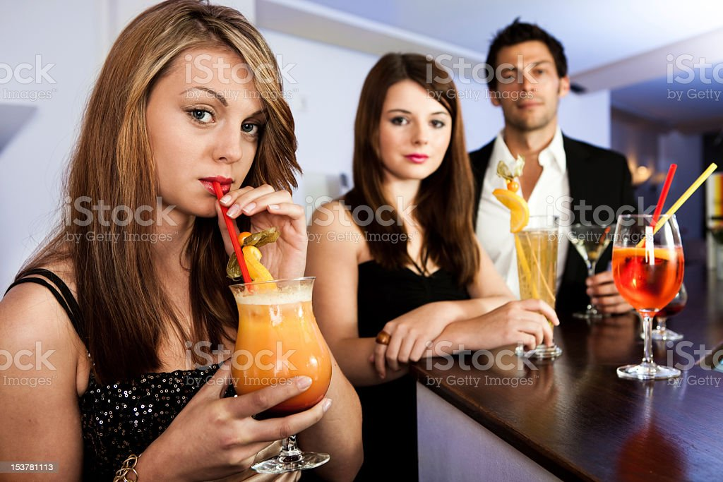 Beautiful women with friends at the bar royalty-free stock photo