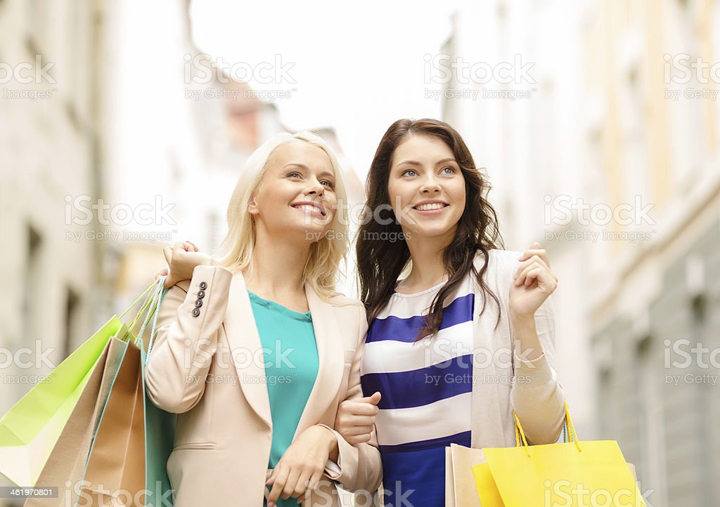 beautiful women with shopping bags in ctiy stock photo