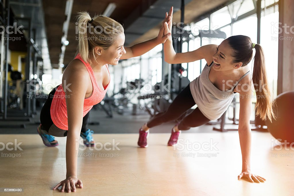 Beautiful women working out in gym stock photo