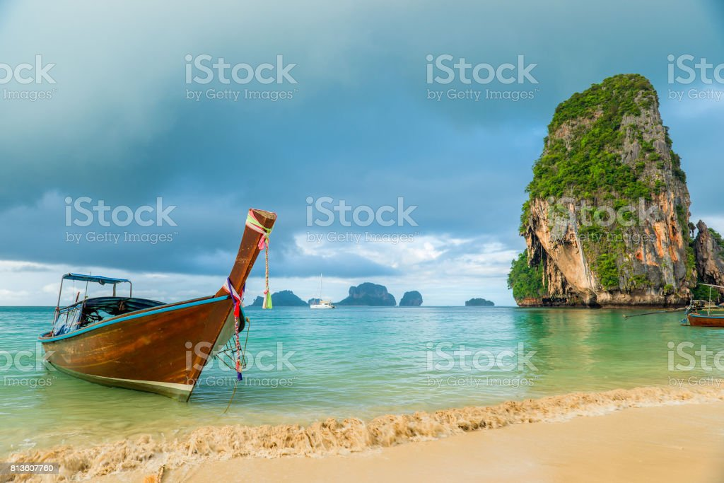 Beautiful wooden boat long tail off the coast of Thailand close-up stock photo