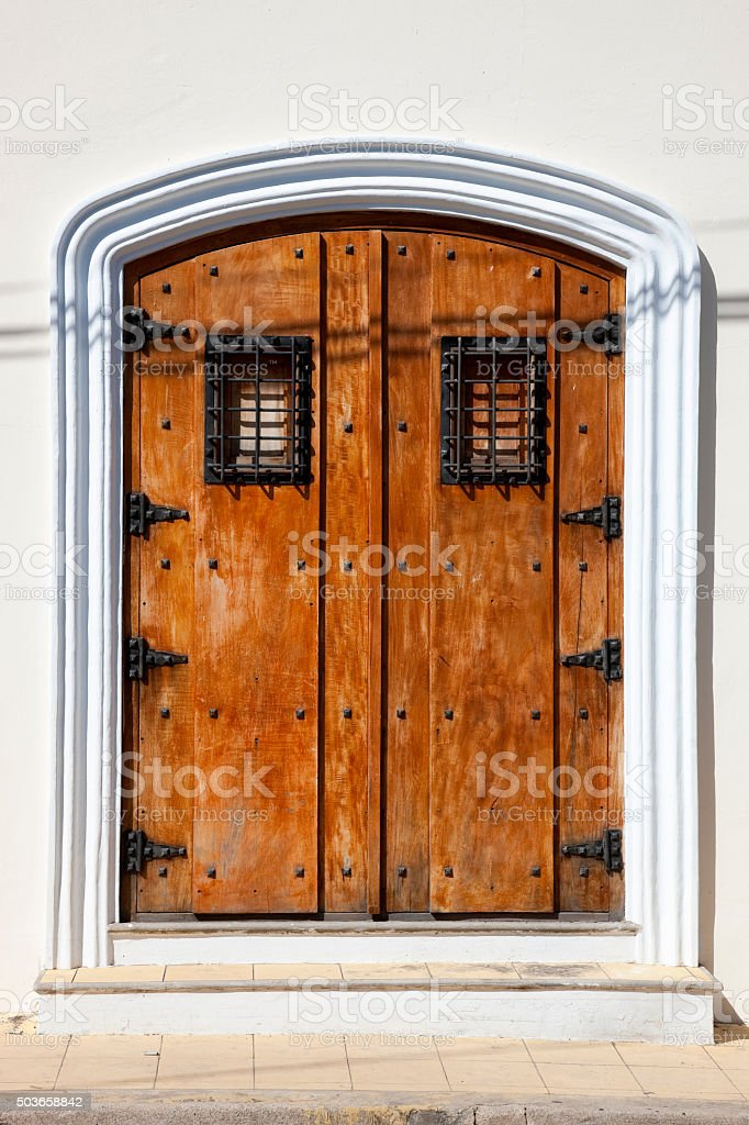 Beautiful wooden door with metal furnishings in Central America stock photo