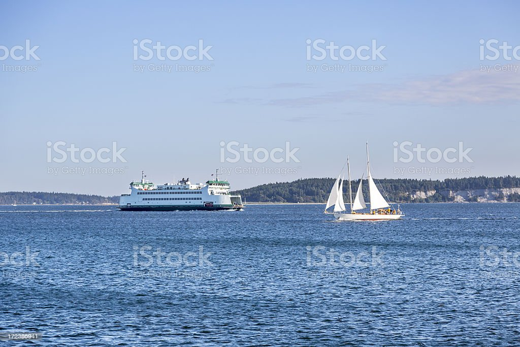 Beautiful Wooden Sailboat and car Ferry Cross Paths royalty-free stock photo