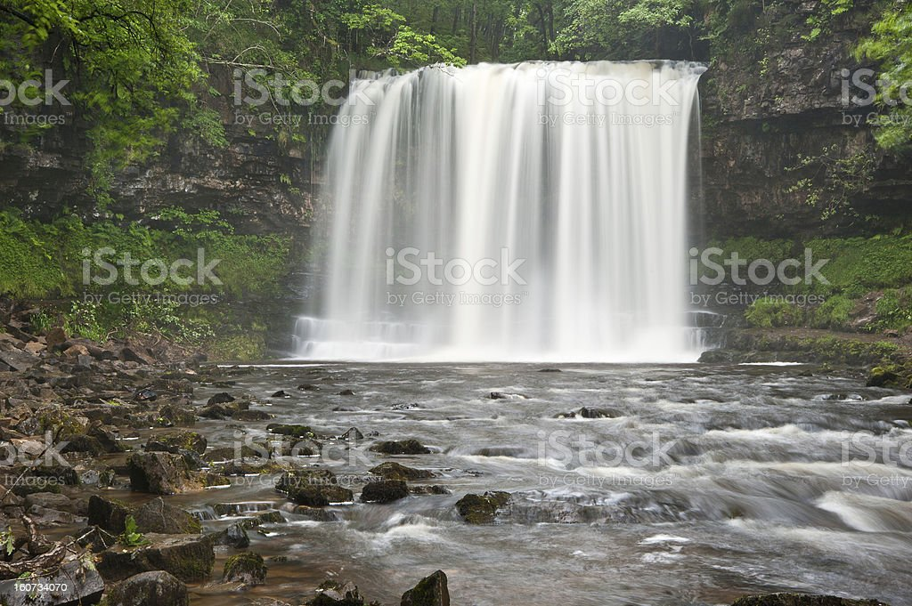Beautiful woodland stream and waterfall in Summer royalty-free stock photo