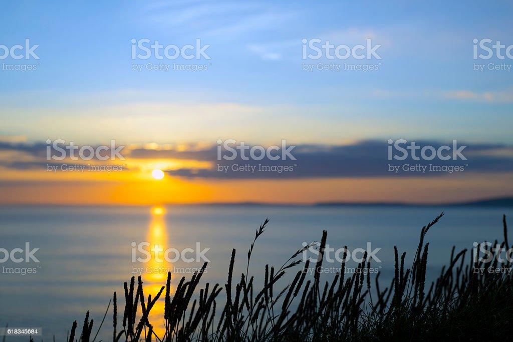 beautiful yellow sunset over loop head stock photo