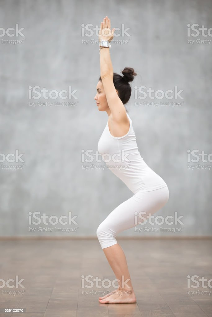 Beautiful Yoga: Chair pose stock photo